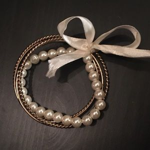 Set of gold & pearl bracelets with ribbon